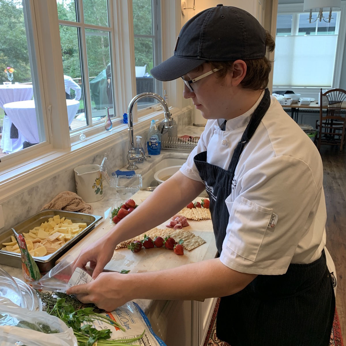 Chef Jacob prepping hors d'oeuvre for pre-dinner reception