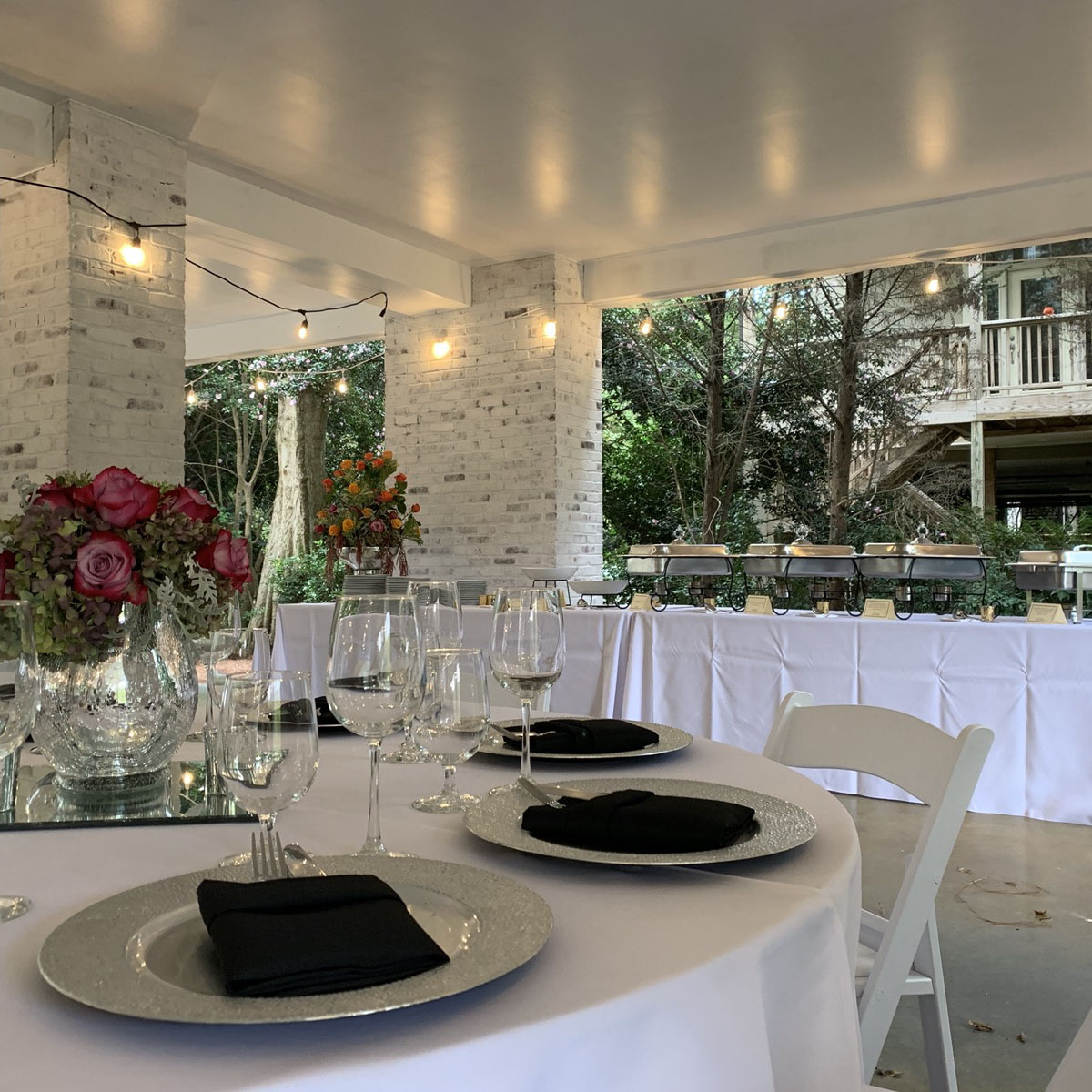 Table set for a backyard buffet dinner in Buckhead