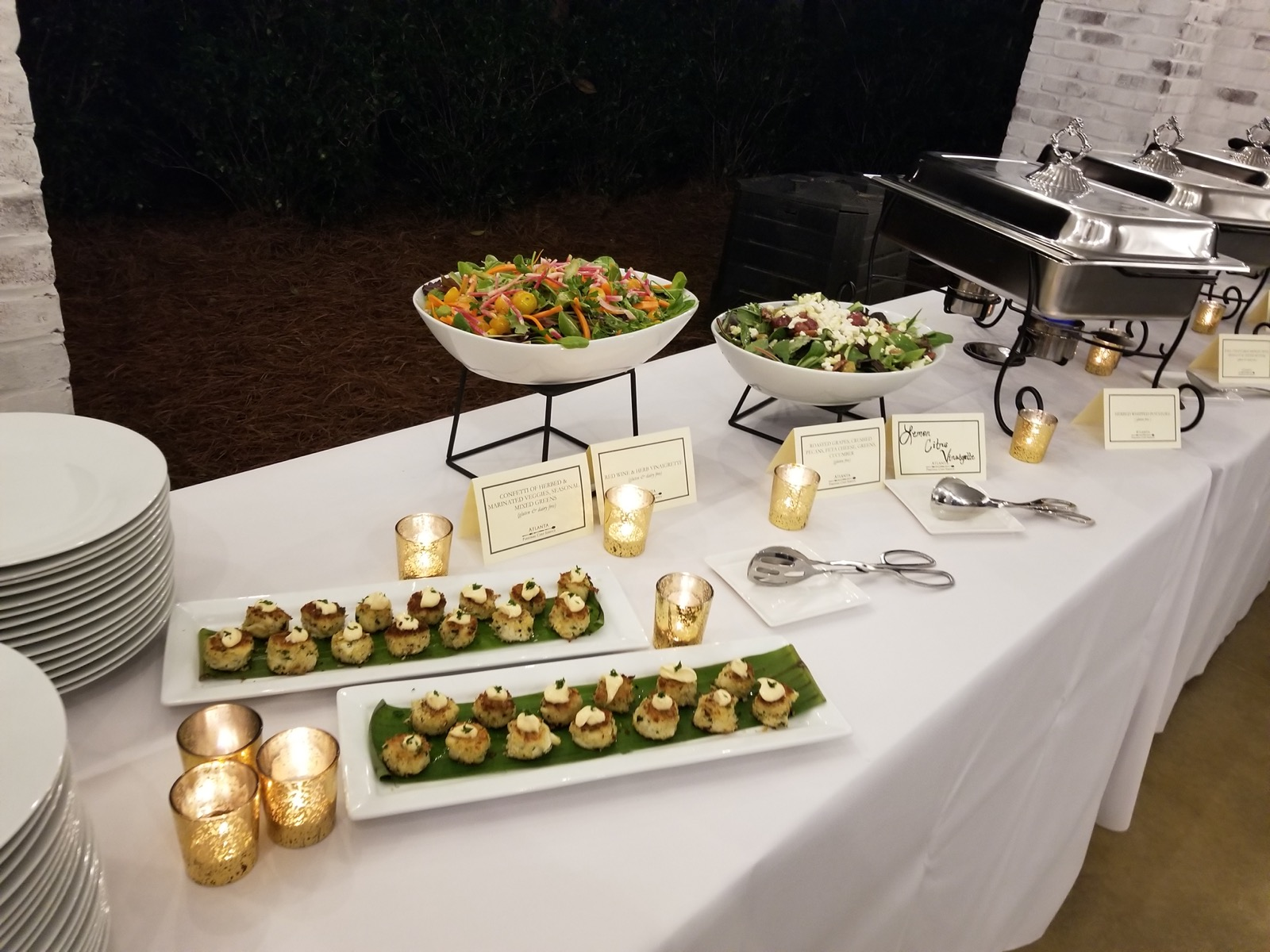 Buffet style dinner with crab cake appetizers and roasted grape salad and confetti vegetable salad