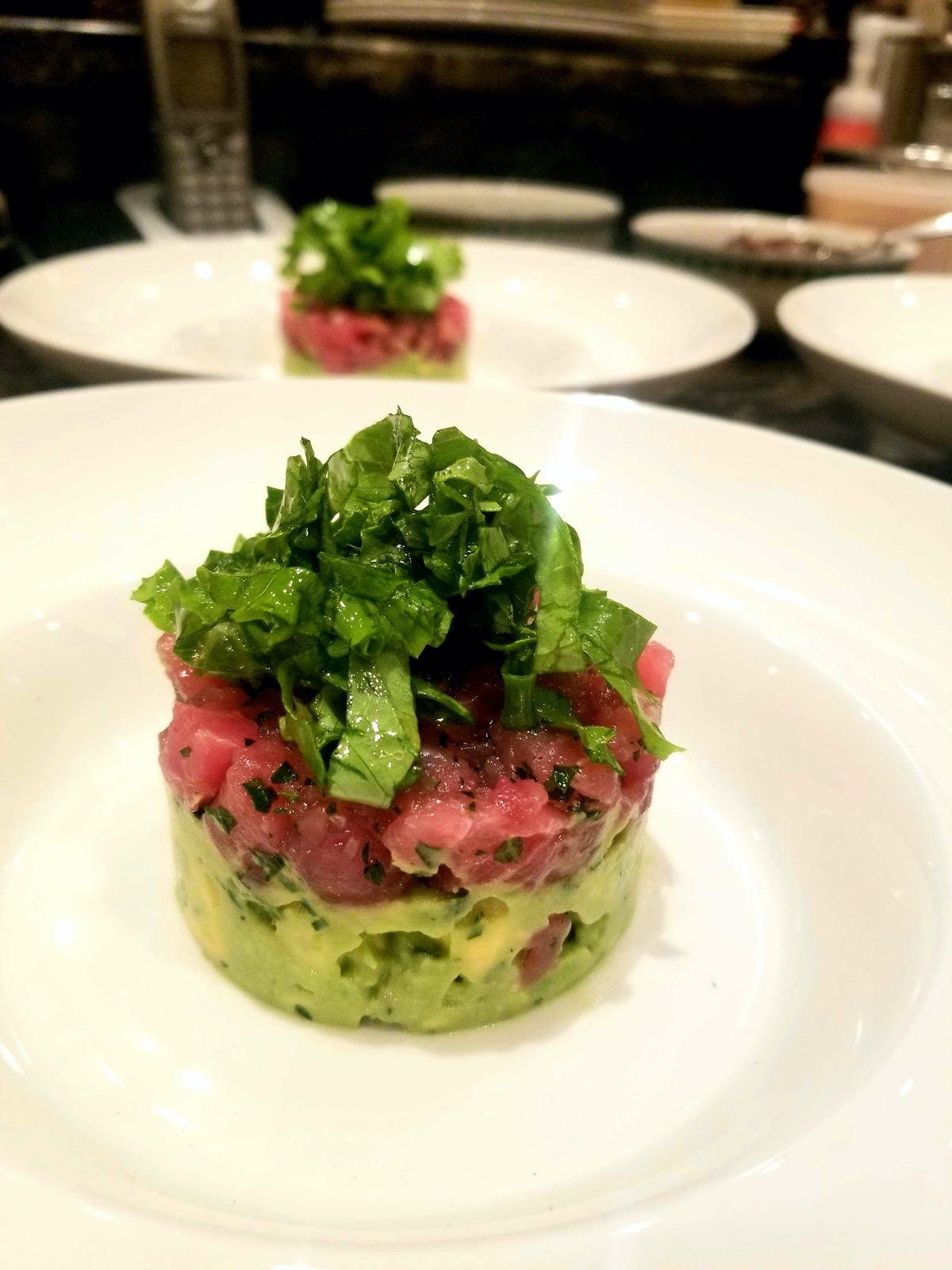 Tuna tartare atop avocado salad is a healthy weeknight dinner option