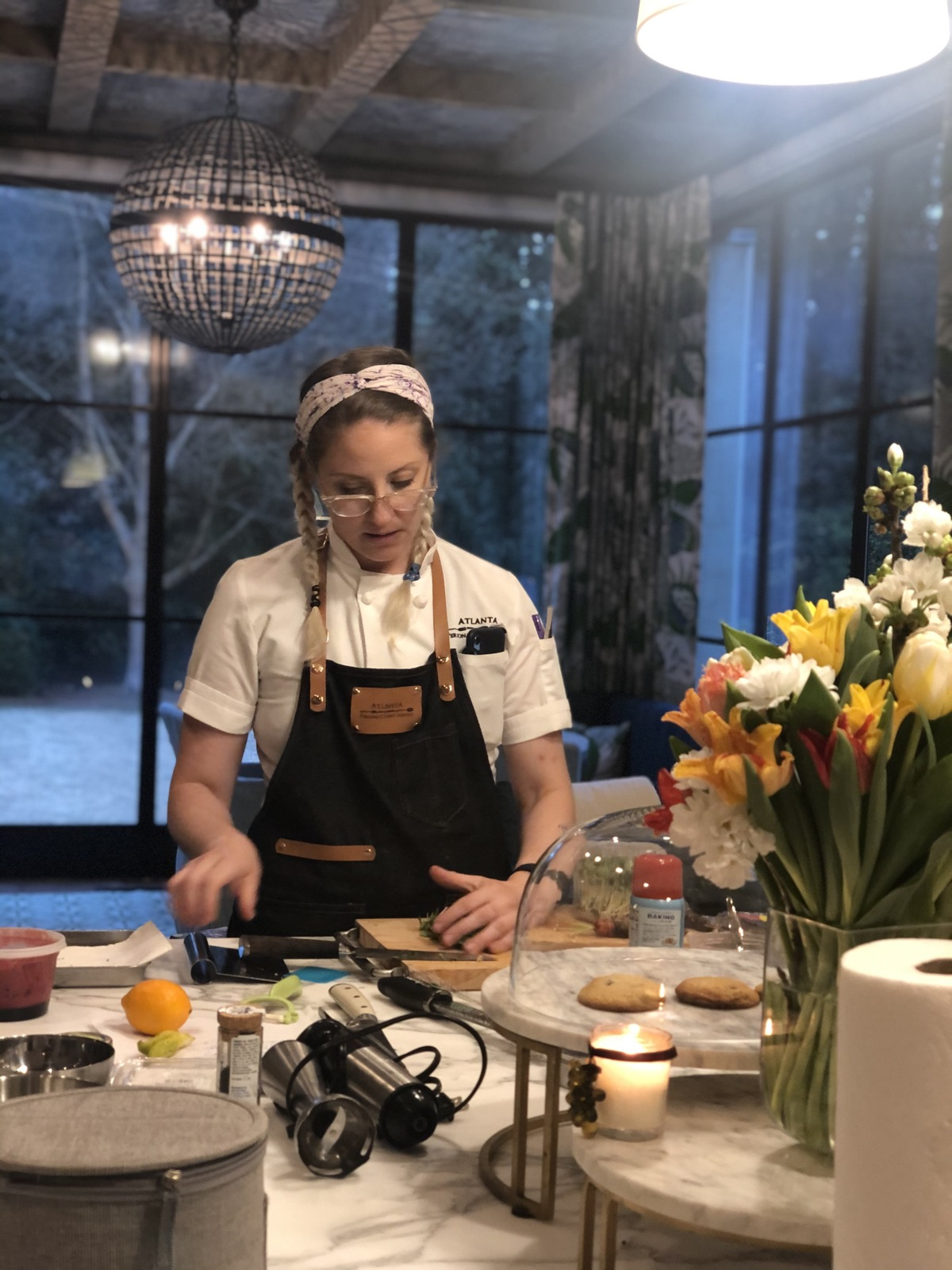 Chef Amanda chops fresh herbs in a Buckhead home kitchen