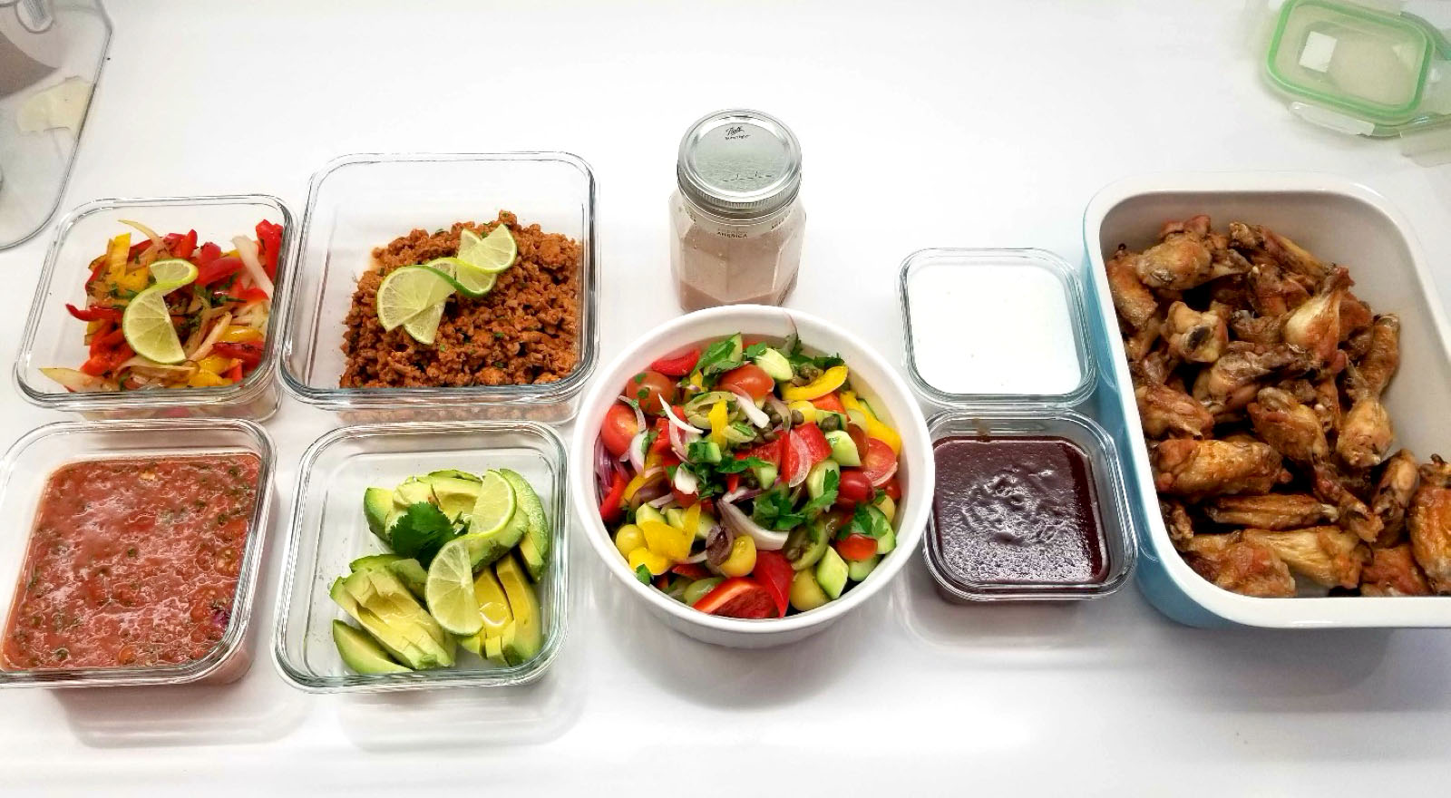 Reusable glass containers of food on a countertop
